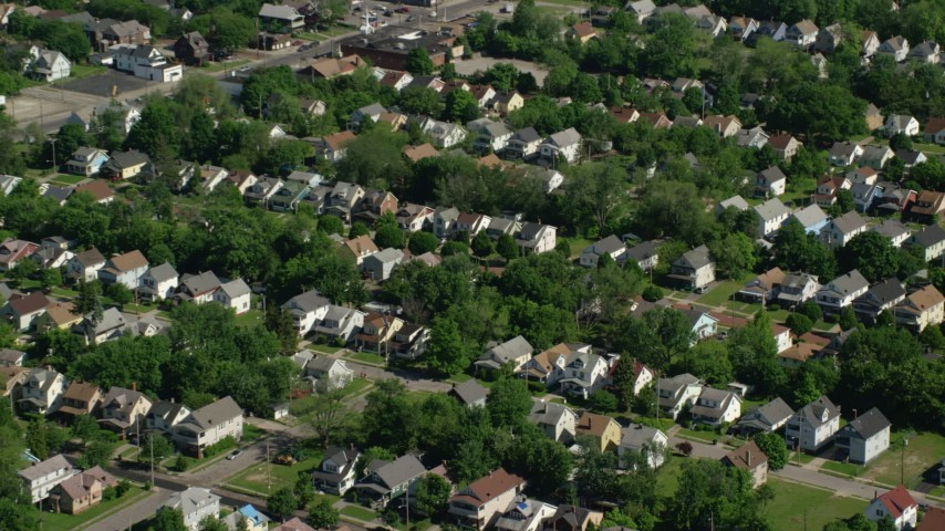 5K stock footage aerial video of suburban homes and trees, Cleveland, Ohio Aerial Stock Footage | AX107_053
