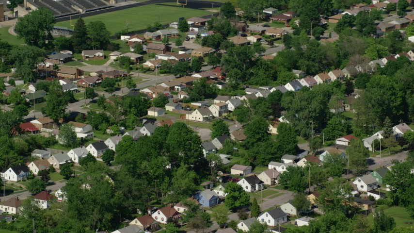 5K stock footage aerial video of suburban homes and trees, Cleveland, Ohio Aerial Stock Footage | AX107_055