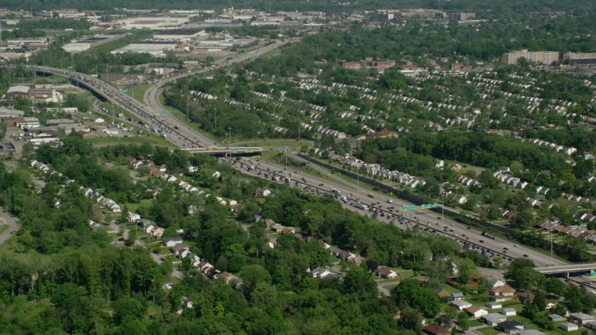 5K stock footage aerial video of suburban homes and heavy traffic on Interstate, Cleveland, Ohio Aerial Stock Footage | AX107_056