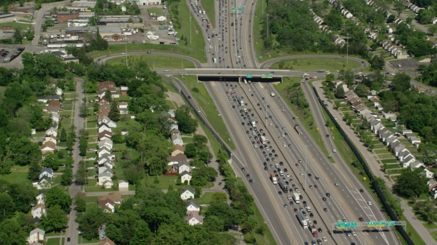 5K stock footage aerial video of heavy traffic on interstate through suburbs, Cleveland, Ohio Aerial Stock Footage | AX107_057