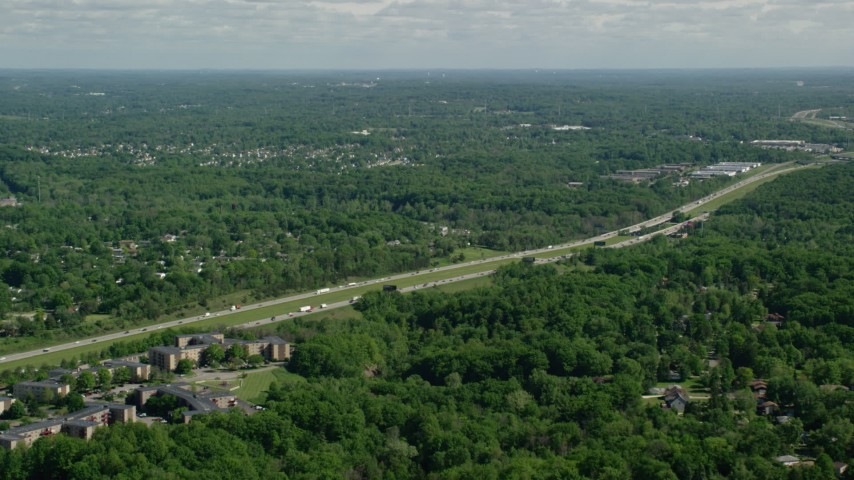 5K aerial video of Interstate with light traffic bordered by trees, Cleveland, Ohio Aerial Stock Footage | AX107_060