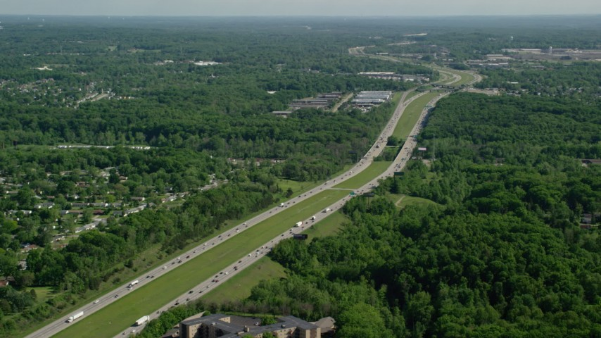 5K stock footage aerial video of an interstate bordered by trees with light traffic, Cleveland, Ohio Aerial Stock Footage | AX107_061