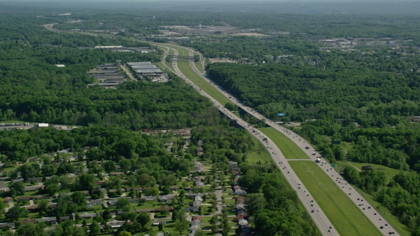5K stock footage aerial video of an interstate among trees with light traffic, Cleveland, Ohio Aerial Stock Footage | AX107_062