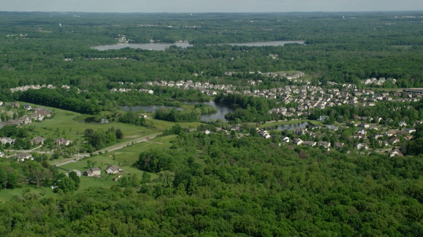 Approaching a lakeside suburban neighborhood aurora ohio aerial approaching a lakeside suburban neighborhood aurora ohio aerial stock footage ax107067 publicscrutiny Image collections