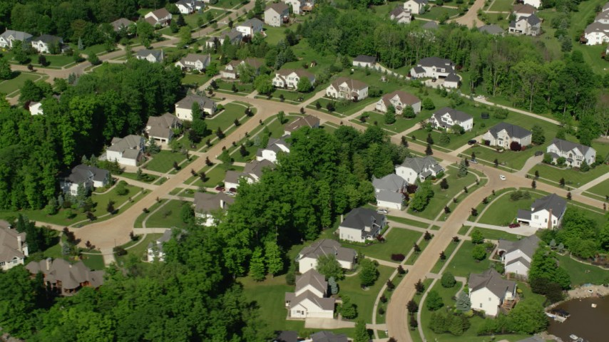 5K aerial video flying along upscale homes, Aurora, Ohio Aerial Stock Footage | AX107_071