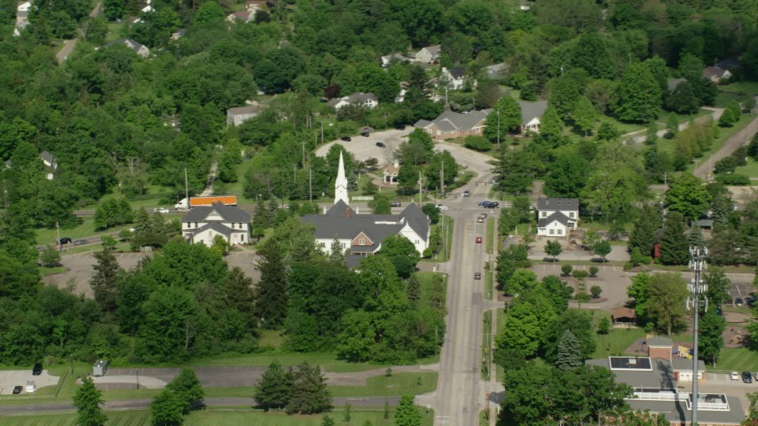 5K aerial video orbiting a church along a busy road, Aurora, Ohio Aerial Stock Footage | AX107_074