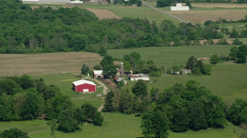 5K aerial video of a farm with a red barn, Aurora, Ohio Aerial Stock Footage | AX107_078