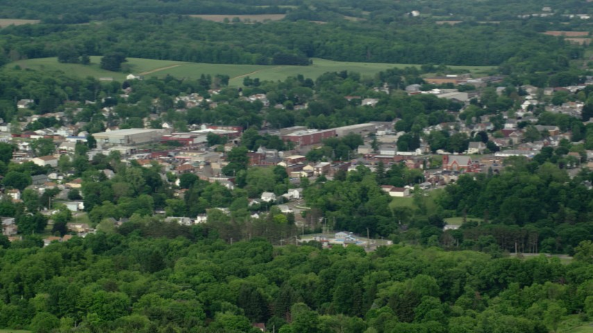 5K stock footage aerial video flying by small town, East Palestine, Ohio Aerial Stock Footage | AX107_115