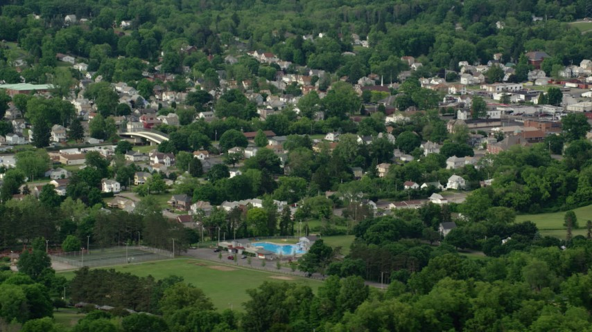 5K stock footage aerial video passing a small town, East Palestine, Ohio Aerial Stock Footage AX107_117 | Axiom Images