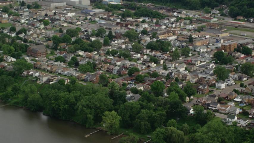 5k aerial video of a suburban community near the river ohio river monaca pennsylvania aerial stock footage ax107_136