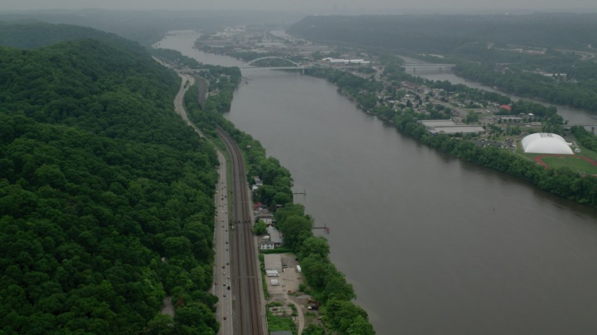 5K stock footage aerial video approaching a small bridge spanning Ohio River to Neville Island, Pittsburgh Aerial Stock Footage | AX107_157