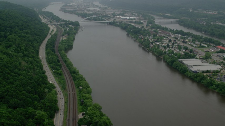 5K stock footage aerial video approaching a small bridge spanning Ohio River to Neville Island, Pittsburgh Aerial Stock Footage | AX107_158