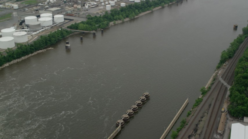 5K stock footage aerial video flying over a river revealing a dam, Ohio River, Pittsburgh, Pennsylvania Aerial Stock Footage | AX107_161
