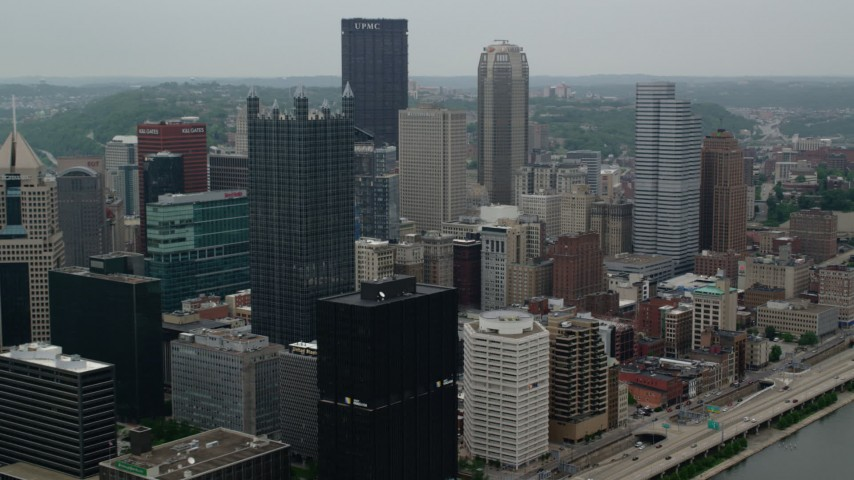 5K stock footage aerial video flying by skyscrapers, Downtown Pittsburgh, Pennsylvania Aerial Stock Footage | AX107_174