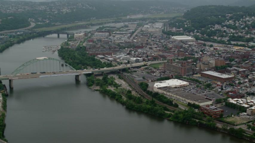 5K stock footage aerial video panning from Birmingham Bridge to an urban neighborhood, Pittsburgh, Pennsylvania Aerial Stock Footage | AX107_178