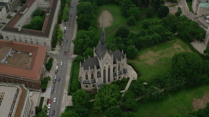 5K aerial video orbiting Heinz Memorial Chapel, University of Pittsburgh, Pennsylvania Aerial Stock Footage | AX107_184