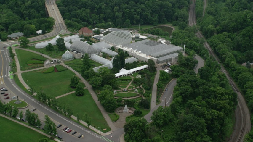 5K stock footage aerial video of Phipps Conservatory & Botanical Gardens, Pittsburgh, Pennsylvania Aerial Stock Footage   AX107_185