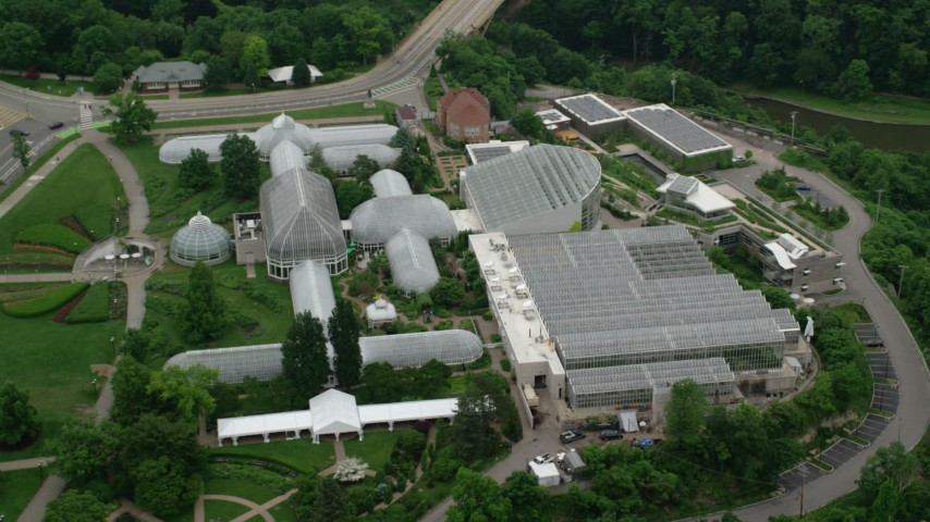 5K stock footage aerial video of Phipps Conservatory & Botanical Gardens, Pittsburgh, Pennsylvania Aerial Stock Footage   AX107_186