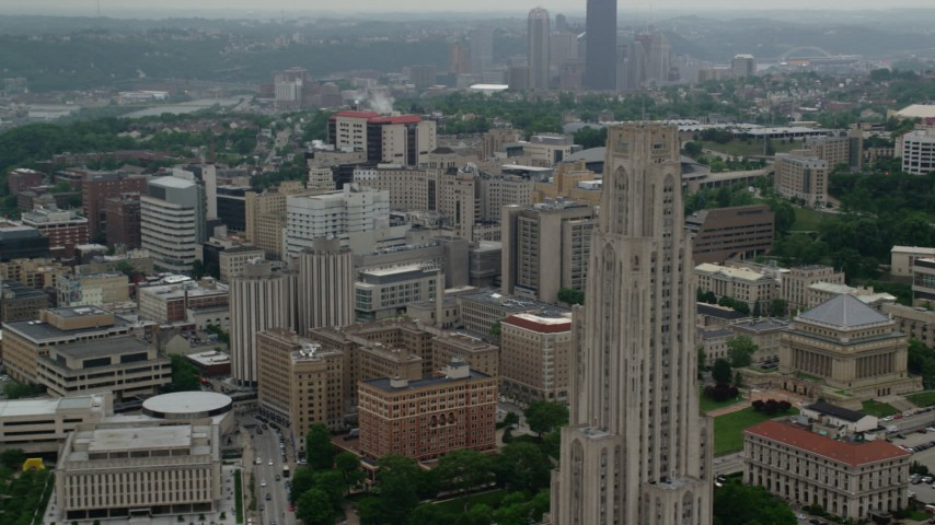 5K aerial video flying by University of Pittsburgh campus, Pennsylvania Aerial Stock Footage | AX107_190