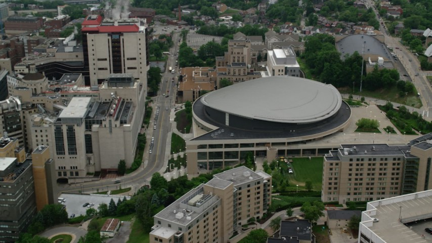 5K stock footage aerial video tilting down on Petersen Events Center, University of Pittsburgh Aerial Stock Footage | AX107_192