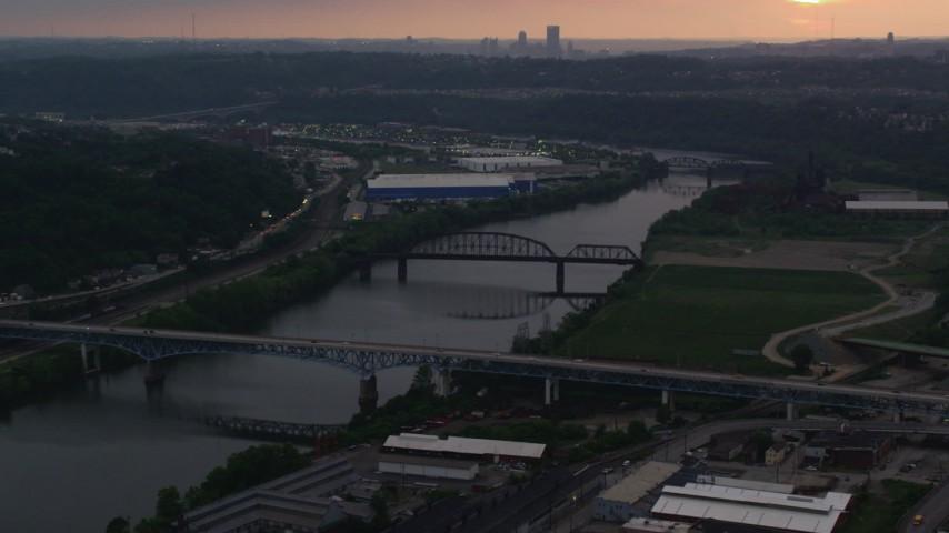 4K stock footage aerial video flying over bridges on the Monogahela River, Munhall, Pennsylvania, twilight Aerial Stock Footage | AX108_041
