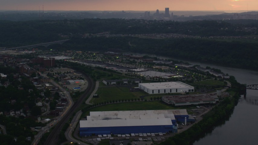 4K stock footage aerial video of Downtown Pittsburgh seen from warehouses, Munhall, Pennsylvania, twilight Aerial Stock Footage | AX108_043