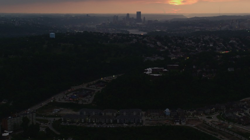 4K stock footage aerial video of Downtown Pittsburgh skyline from a distance, Pennsylvania, sunset Aerial Stock Footage | AX108_046