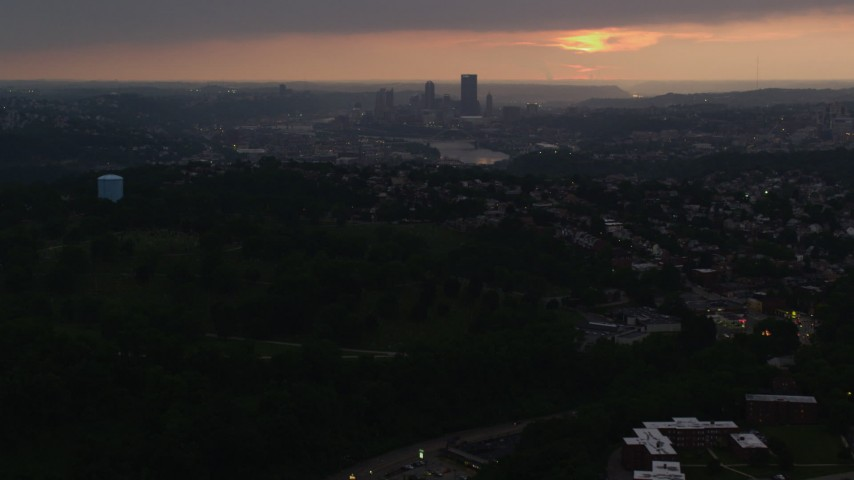 4K stock footage aerial video of Downtown Pittsburgh skyline from a distance, Pennsylvania, sunset Aerial Stock Footage | AX108_047