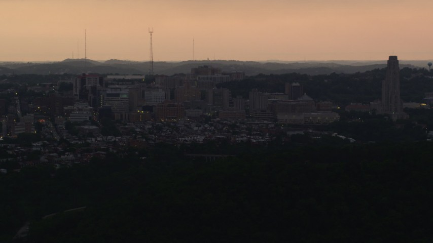 4K stock footage aerial video of University of Pittsburgh campus, Pennsylvania, sunset Aerial Stock Footage | AX108_050