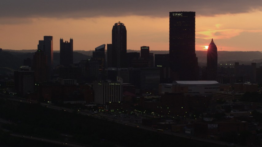 4K stock footage aerial video of Downtown Pittsburgh skyscrapers and office buildings, Pennsylvania, sunset Aerial Stock Footage | AX108_056