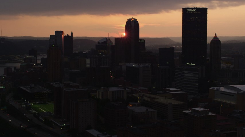 4K stock footage aerial video of Downtown Pittsburgh skyscrapers, Pennsylvania, sunset Aerial Stock Footage | AX108_058