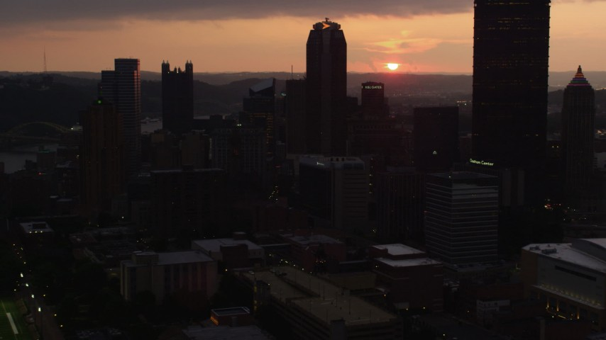 4K stock footage aerial video flying by skyscrapers, Downtown Pittsburgh, Pennsylvania, sunset Aerial Stock Footage | AX108_059