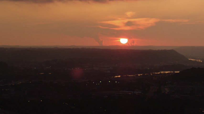 4K stock footage aerial video of the Ohio River and setting sun seen from Downtown Pittsburgh, Pennsylvania, sunset Aerial Stock Footage | AX108_061