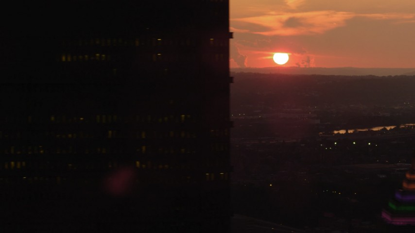 4K stock footage aerial video flying by U.S. Steel Tower, Downtown Pittsburgh, Pennsylvania, sunset Aerial Stock Footage   AX108_062