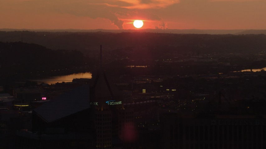 4K stock footage aerial video flying by skyscrapers revealing West End Bridge, Pittsburgh, Pennsylvania, sunset Aerial Stock Footage | AX108_063