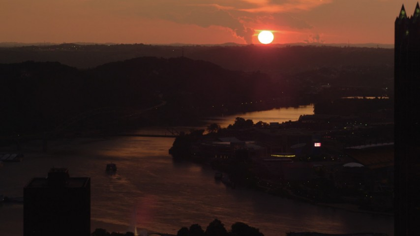 4K stock footage aerial video of the West End Bridge spanning the Ohio River, Pittsburgh, sunset Aerial Stock Footage   AX108_064