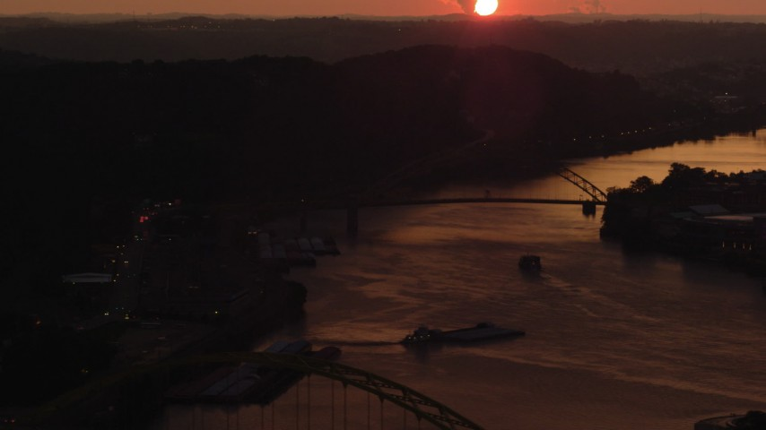 4K stock footage aerial video of the West End Bridge spanning the Ohio River, Pittsburgh, sunset Aerial Stock Footage | AX108_065
