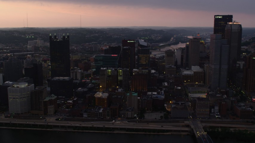4K stock footage aerial video of Downtown Pittsburgh seen from Monongahela River, Pennsylvania, twilight Aerial Stock Footage | AX108_066
