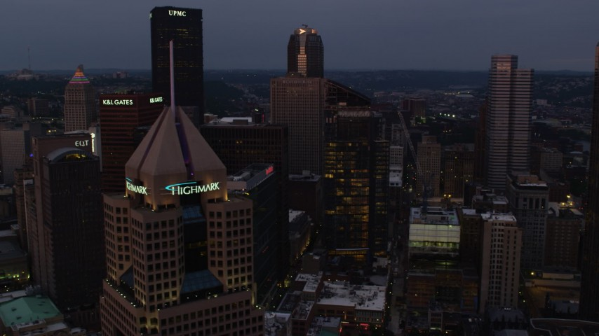 4K stock footage aerial video of Fifth Avenue Place and downtown skyscrapers, Pittsburgh, twilight Aerial Stock Footage | AX108_070