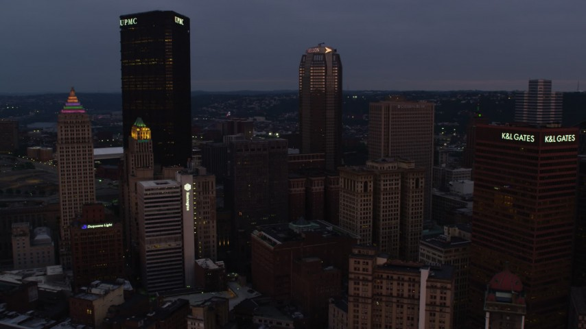 4K stock footage aerial video of U.S. Steel Tower and BNY Mellon Center, Pittsburgh, Pennsylvania, twilight Aerial Stock Footage | AX108_072