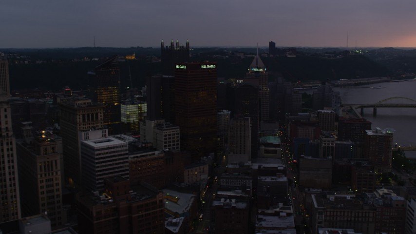 4K stock footage aerial video of Gulf Tower and skyscrapers, Downtown Pittsburgh, Pennsylvania, twilight Aerial Stock Footage | AX108_074