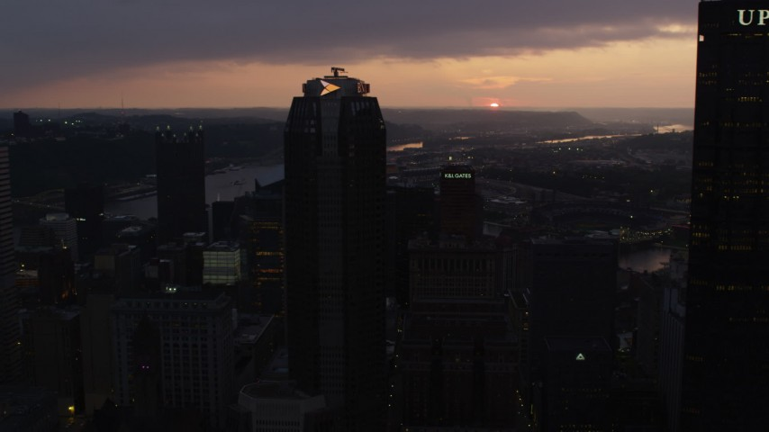 4K stock footage aerial video flying by BNY Mellon Center and office buildings, Downtown Pittsburgh, Pennsylvania, twilight Aerial Stock Footage | AX108_077