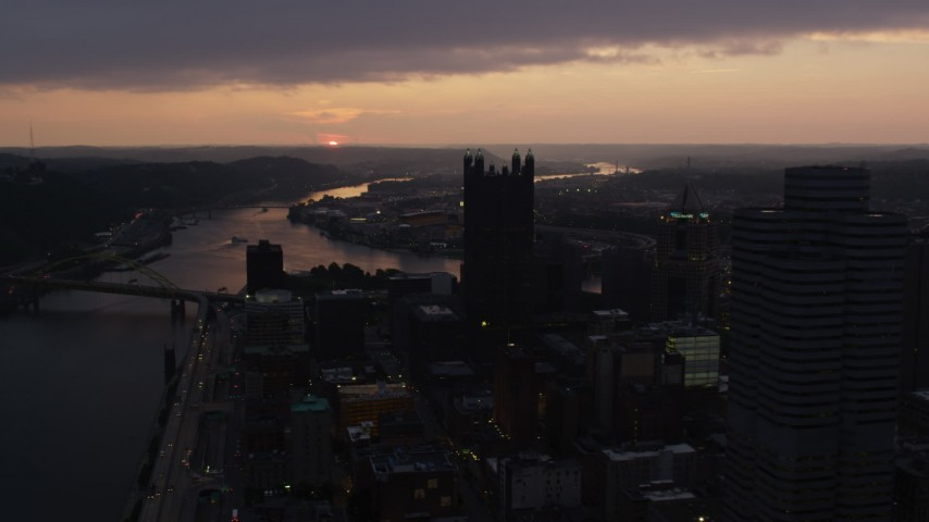 4K stock footage aerial video of Fort Pitt Bridge spanning Ohio River, Downtown Pittsburgh, Pennsylvania, twilight Aerial Stock Footage | AX108_079