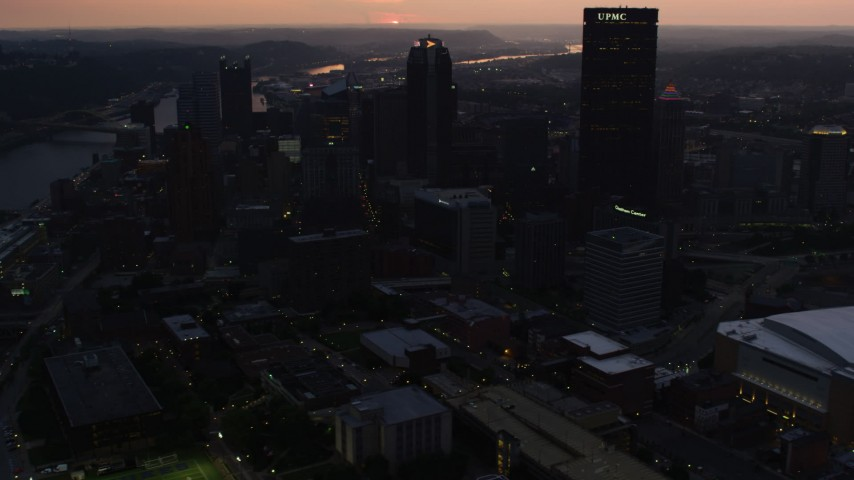4K stock footage aerial video approaching skyscrapers, Downtown Pittsburgh, Pennsylvania, twilight Aerial Stock Footage | AX108_081