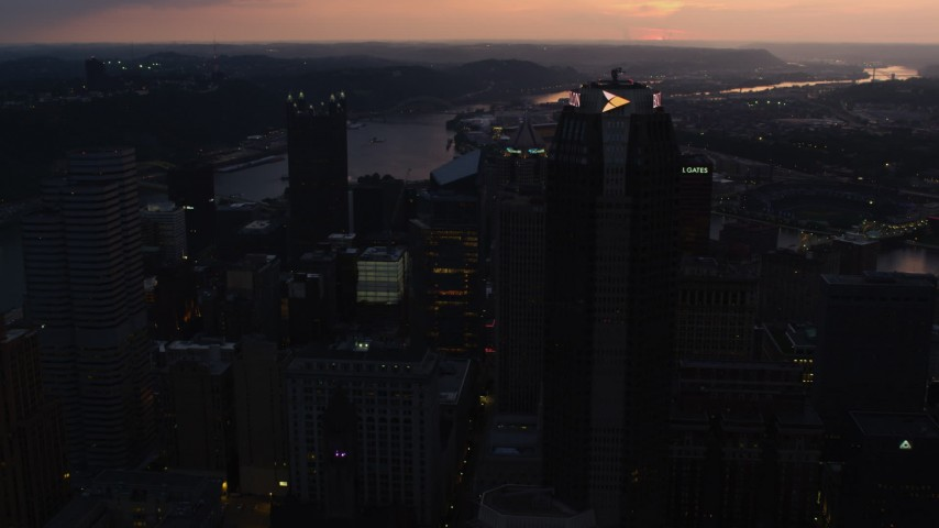 4K stock footage aerial video flying by BNY Mellon Center toward PPG Place, Downtown Pittsburgh, Pennsylvania, twilight Aerial Stock Footage | AX108_083