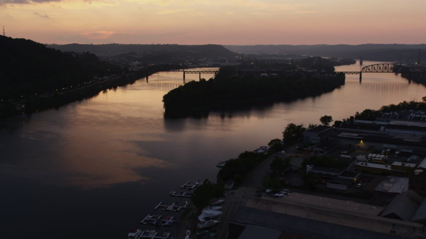 4K stock footage aerial video of Brunot Island on the Ohio River, Pittsburgh, Pennsylvania, twilight Aerial Stock Footage | AX108_092