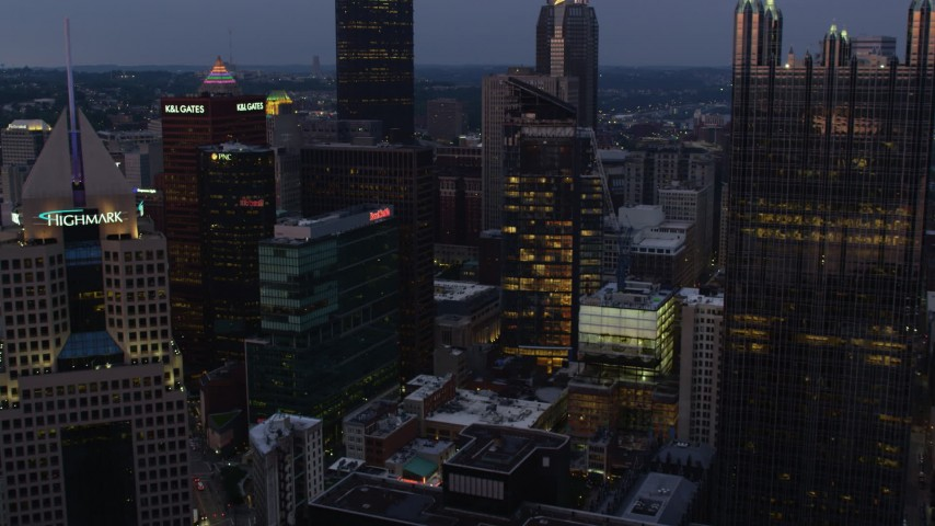 4K stock footage aerial video flying over skyscrapers, Downtown Pittsburgh, Pennsylvania, twilight Aerial Stock Footage | AX108_100