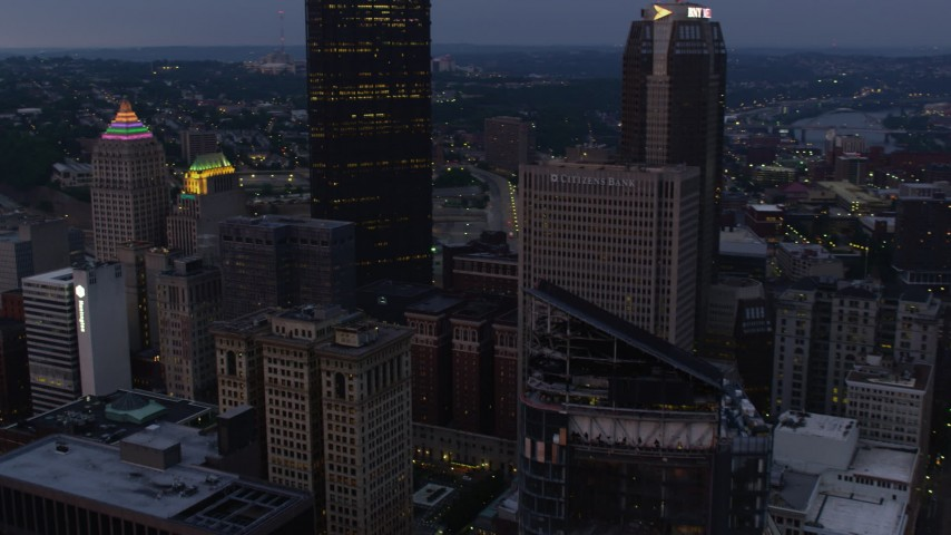 4K stock footage aerial video flying by skyscrapers, Downtown Pittsburgh, Pennsylvania, twilight Aerial Stock Footage | AX108_101