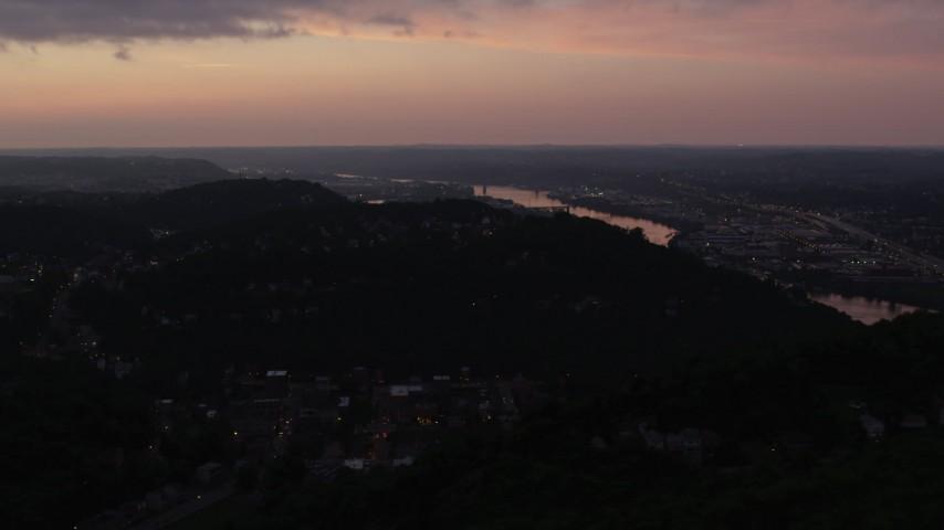 4K stock footage aerial video flying over hilltop residential neighborhoods, Pittsburgh, Pennsylvania, twilight Aerial Stock Footage | AX108_107