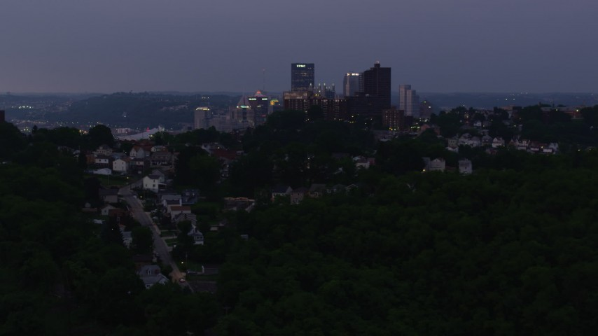 4K stock footage aerial video of Hilltop residential neighborhoods, Pittsburgh, Pennsylvania, twilight Aerial Stock Footage | AX108_108